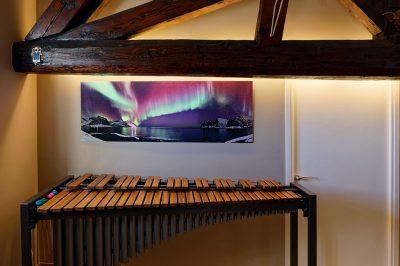 Photo d'art d'aurore boréale, chez un client de Krom Galerie